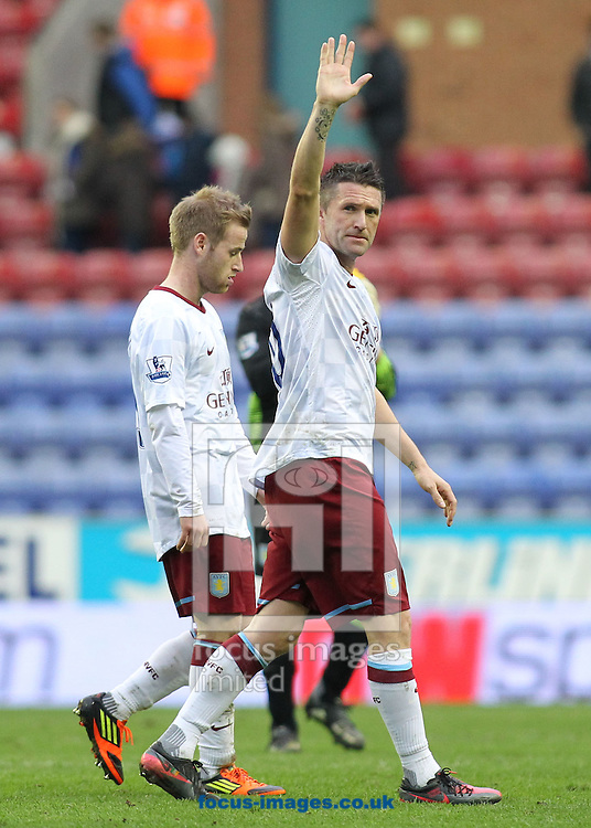 Picture by MIchael Sedgwick/Focus Images Ltd. 07900 363072.25/02/12.Robbie Keane waves to the fans after his final appearance for Aston Villa against Wigan Athletic in the Barclays Premier League at the DW Stadium, Wigan.