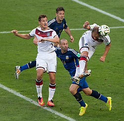July 13, 2014 - Rio de Janeiro, Brazil - BENEDIKT HOWEDES, right, of Germany heads the ball for a shot on goal goal during the final of the World Cup between Germany and Argentina, held at Maracana Stadium. (Credit Image: © 725) Marcelo Machado De Melo/Fotoarena/ZUMA Wire)
