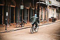 Street performer rides bicycle through French Quarter of New Orleans, LA. Copyright 2011.