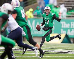 Oct 3, 2015; Huntington, WV, USA; Marshall Thundering Herd quarterback Chase Litton scrambles out of the pocket during the second quarter against the Old Dominion Monarchs at Joan C. Edwards Stadium. Mandatory Credit: Ben Queen-USA TODAY Sports