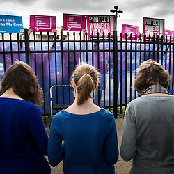 Lisa Johnston | lisajohnston@archstl.org  | Twitter: @aeternusphoto Anna, Julia and Barb Kalinowski prayed the rosary with about 450 pro-life supporters outside of Planned Parenthood. Pro-life supporters processed from the Cathedral Basilica to Planned Parenthood on Forest Park Avenue where they were met by pink signs held by counter protesters supporting the abortion provider. Supporters of the abortion provided held signs behind a recently modified fence meant to obscure their view.