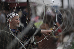 61014158<br /> A Palestinian waits to enter Egypt through the Rafah border crossing in the southern Gaza Strip on Feb. 4, 2014. Egypt on Tuesday reopened its border with the Gaza Strip after keeping the Palestinian enclave s only prime gate to the outside world shut for 12 days, Gaza Strip, Tuesday, 4th February 2014. Picture by  imago / i-Images<br /> UK ONLY