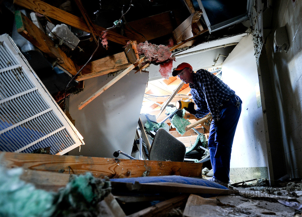 Photo by Gary Cosby Jr.   East Limestone, Ala., residents begin the recovery process Thursday, April 28, 2011 after Wednesday's devastating tornado swept through the area.  Jimmy Clark, preacher at Bethel Church of Christ on Highway 72 East of Athens, looks through the remains of the building.