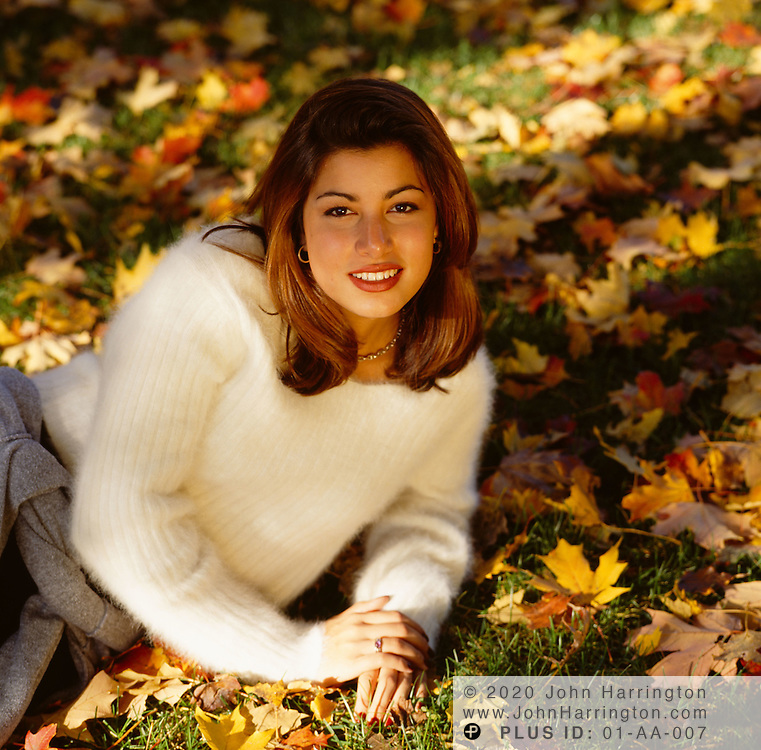 Woman posing in the autumn grass<br />