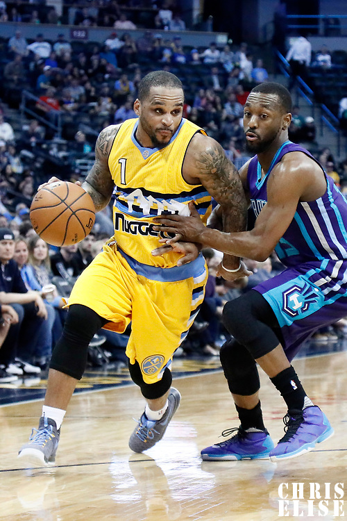 04 March 2017: Denver Nuggets guard Jameer Nelson (1) drives past Charlotte Hornets guard Kemba Walker (15) during the Charlotte Hornets 112-102 victory over the Denver Nuggets, at the Pepsi Center, Denver, Colorado, USA.