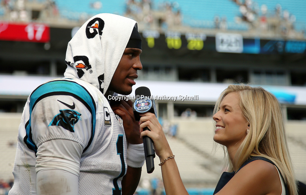 Carolina Panthers quarterback Cam Newton (1) does a postgame television interview with a sideline reporter after winning the 2015 NFL week 2 regular season football game against the Houston Texans on Sunday, Sept. 20, 2015 in Charlotte, N.C. The Panthers won the game 24-17. (©Paul Anthony Spinelli)