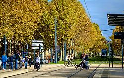 Pedestrians crossing the tram lines at the Palais de Justice, Toulouse, FRance<br /> <br /> (c) Andrew Wilson | Edinburgh Elite media
