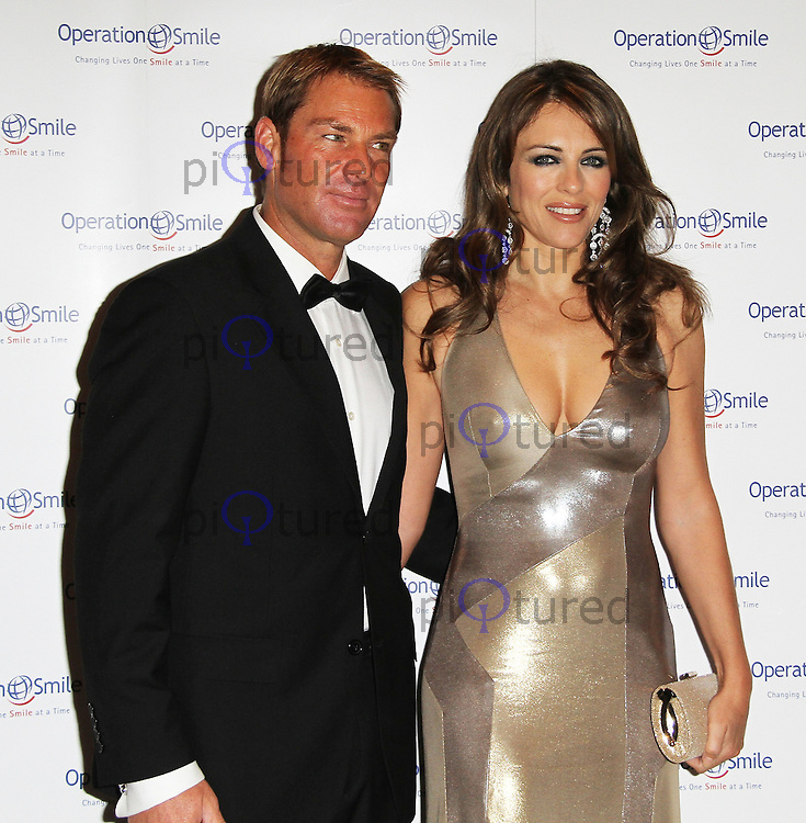 Shane Warne; Elizabeth Hurley Operation Smile Ball, Hurligham club, Fulham, London, UK. 10 November 2011. Contact rich@pictured.com +44 07941 079620 (Picture by Richard Goldschmidt)