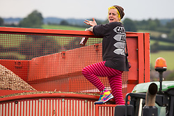 An anti-HS2 activist occupies a trailer being used to transport wood chip in order to try to prevent or delay tree felling alongside the Fosse Way in connection with the HS2 high-speed rail link on 24th August 2020 in Offchurch, United Kingdom. The controversial HS2 infrastructure project is currently expected to cost £106bn and will destroy or significantly impact many irreplaceable natural habitats, including 108 ancient woodlands.