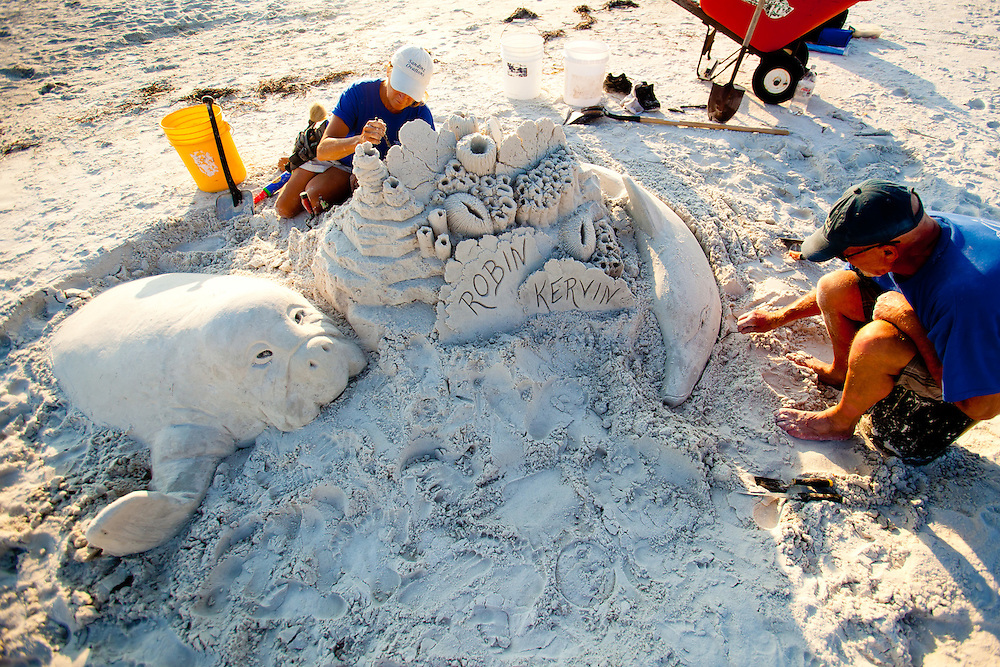 A large manatee sand sculpture is prepared for a wedding by Meredith Corson of Sanding Ovations along St. Pete Beach.