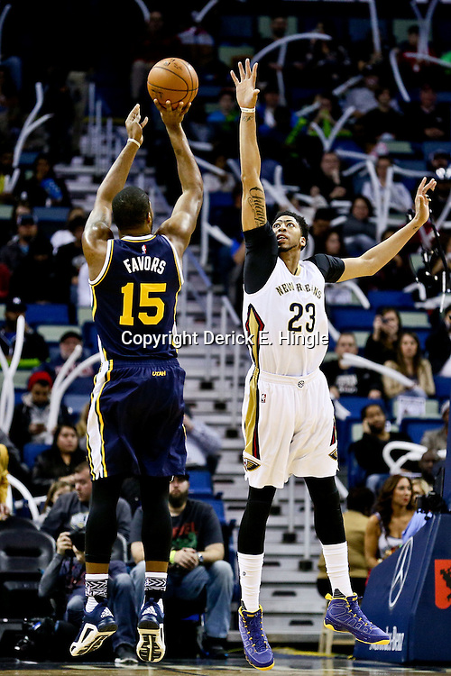 Feb 10, 2016; New Orleans, LA, USA; Utah Jazz forward Derrick Favors (15) shoots over New Orleans Pelicans forward Anthony Davis (23) during the first quarter of a game at the Smoothie King Center. Mandatory Credit: Derick E. Hingle-USA TODAY Sports