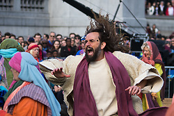 Trafalgar Square, London, March 25th 2016. Thousands of Londoners an tourists in Trafalgar Square are treated to The Passion of Jesus, a re-enactment of the events leading up to the crucifixion and resurrection of Jesus Christ. PICTURED: Jesus chases the traders out of the temple. <br /> &copy;Paul Davey<br /> FOR LICENCING CONTACT: Paul Davey +44 (0) 7966 016 296 paul@pauldaveycreative.co.uk