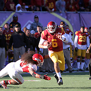 USC QB Cody Kessler scampers for a 2ns Half 1st Down.  The USC Trojans defeated the Fresno State Bulldogs 45-20 at the Royal Purple Las Vegas Bowl, Sam Boyd Stadium, Las Vegas, Nevada.  Photo by Barry Markowitz, <br /> 12/21/13, 3:30pm
