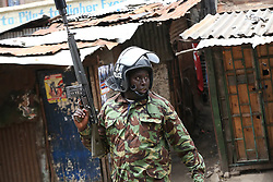 August 9, 2017 - Nairobi, Kenya - A police officer follows protesters during demonstrations in the streets of the Mathare slum. At least five people have been killed in post-election violence in Kenya after Odinga announced that he rejects the provisional result of the presidential election announced by the electoral body. (Credit Image: © Tom Maruko/Pacific Press via ZUMA Wire)