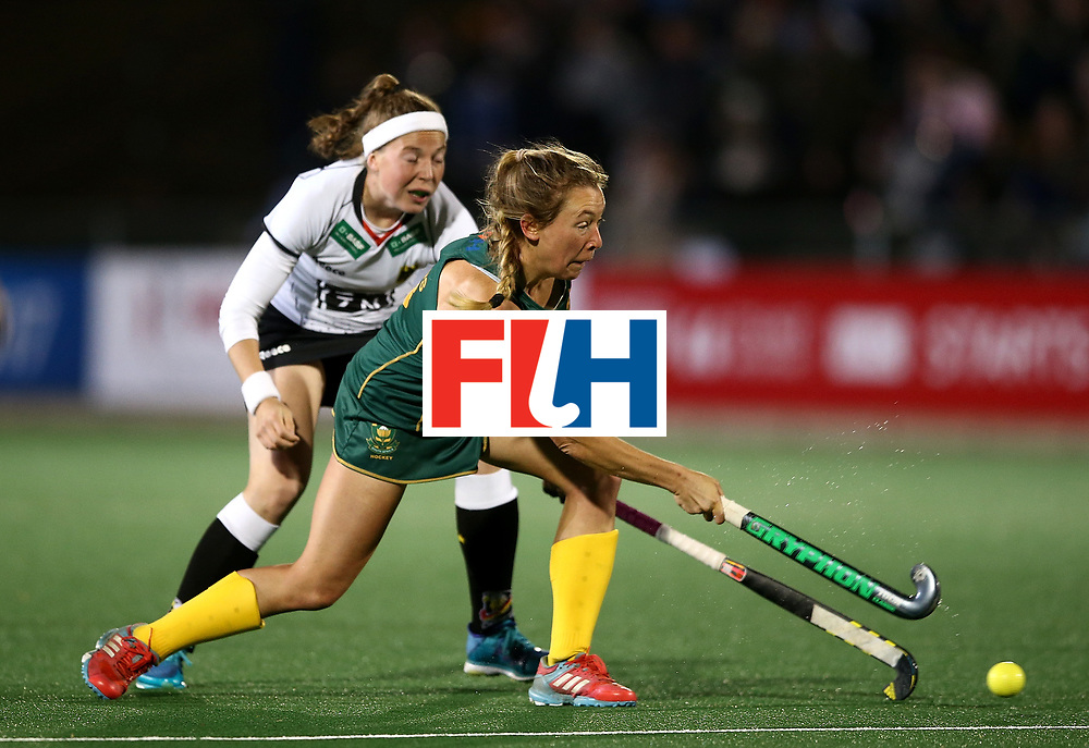 JOHANNESBURG, SOUTH AFRICA - JULY 18:  Celia Evans of South Africa battles with Teresa Martin Pelegrina of Germany during day 6 of the FIH Hockey World League Women's Semi Finals quarter final match between Germany and South Africa at Wits Univesity on July 18, 2017 in Johannesburg, South Africa.  (Photo by Jan Kruger/Getty Images for FIH)