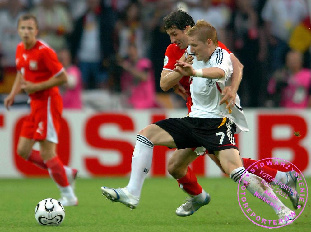 n/z.: Radoslaw Sobolewski (nr7-Polska) , Bastian Schweinsteiger (nr7-Niemcy) podczas meczu grupy A Polska (czerwone) - Niemcy 0:1 podczas turnieju finalowego Mistrzostw Swiata Niemcy 2006 , pilka nozna , Niemcy , Dortmund , 14-06-2006 , fot.: Adam Nurkiewicz / mediasport..Radoslaw Sobolewski (nr7-Poland) and Bastian Schweinsteiger (nr7-Germany) during soccer match group A in Dortmund during World Cup 2006. June 14, 2006 ; Poland (red) - Germany 0:1 ; football , Germany , Dortmund ( Photo by Adam Nurkiewicz / mediasport )