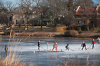 Minneapolis, MN - Dec 28, 2011 Just a few days before Christmas is a perfect time for some pond hockey on Lake of the Isles in Minneapolis, Minnesota. The lake froze very smooth lending itself to some nice skating.