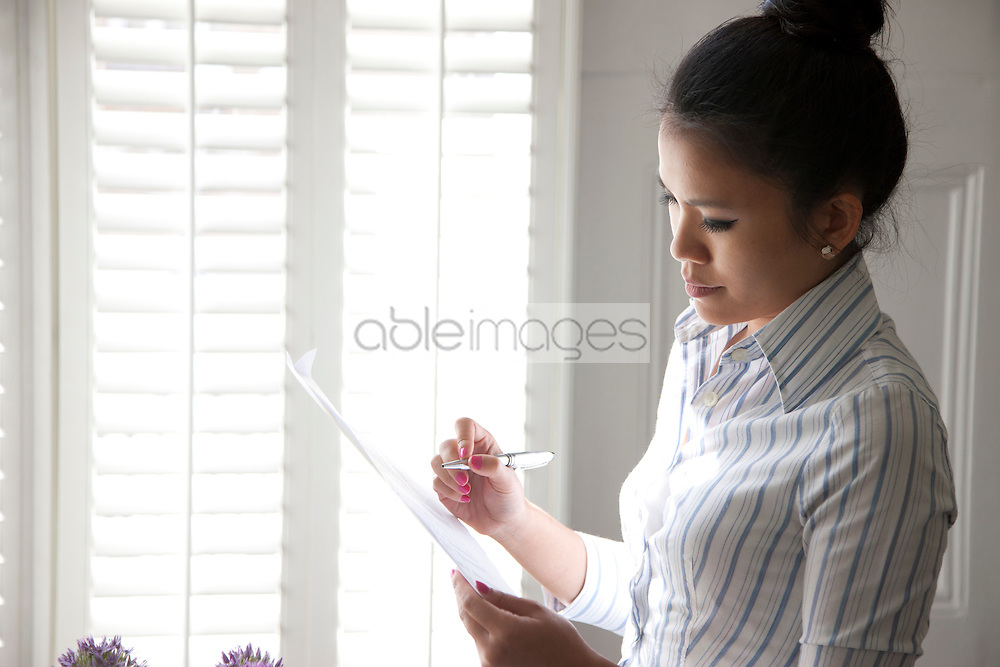 Businesswoman Looking Over Document