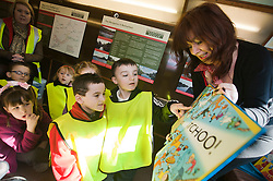 """The Children of Ryecroft school Rawmarsh celebrate World Book Day at Parkgate Shopping Rotherham listening to childrens author Michaela Morgan reading her book """"Never Shake A Rattle Snake"""" on the top deck of one of the Yorkshire Transports Museums buses which was parked outside W.H. Smiths espcially for the occasion...http://www.pauldaviddrabble.co.uk..1 March 2012 -  Image © Paul David Drabble"""