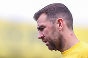 Crystal Palace midfielder James McArthur (18) warms up prior to the Premier League match between Crystal Palace and Huddersfield Town at Selhurst Park, London, England on 30 March 2019.