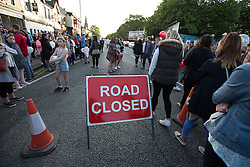 © Licensed to London News Pictures . 10/06/2015 . Manchester , UK . A vigil in memory of Dominic Doyle , near to where he was found fatally stabbed on Sunday morning (7th June 2015) , on Manchester Road in East Manchester . The Manchester Road (A57) is closed to traffic as hundreds gather to remember the 21 year old . Three people have been charged in connection with Doyle's murder and a 16 year old has been arrested on suspicion of murder . Photo credit : Joel Goodman/LNP
