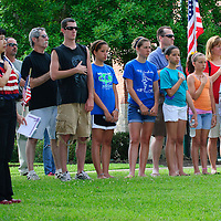 Patrons sing the National Anthem during the dedication of the new Friendswood Veterans Memorial that was dedicated today.
