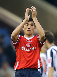 WEST BROMWICH, ENGLAND - Saturday, December 15, 2007: Charlton's Zhi Zheng applauds the fans after his side's 4-2 defeat by West Bromwich Albion during the League Championship match at the Hawthorns. (Photo by David Rawcliffe/Propaganda)