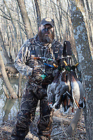 hunter with a harvested mallard drake