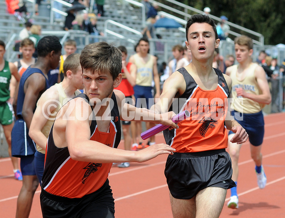 Pennsbury's Ryan Merriman (left) receives a handoff from Jed Scratchard in the 4 x 800 relay during the Central Bucks West Relays at Central Bucks West High School Saturday April 23, 2016 in Doylestown, Pennsylvania. (Photo by William Thomas Cain)
