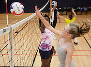 Erin Cornell, 10, of Port Jervis hits the ball out of instructor Aliyah Sullivan's hand at Whoosh Volleyball Camp at SUNY Orange on Wednesday, Aug. 12, 2009.