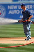 LOS ANGELES - MAY 03:  A groundskeeper waters the infield prior to the Los Angeles Dodgers game against the San Diego Padres at Dodger Stadium on Sunday, May 3, 2009 in Los Angeles, California.  The Dodgers won their 10th straight home game while defeating the Padres 7-3.  (Photo by Paul Spinelli/MLB Photos)