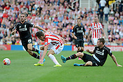 James Milner tackles Marco van Ginkel during the Barclays Premier League match between Stoke City and Liverpool at the Britannia Stadium, Stoke-on-Trent, England on 9 August 2015. Photo by Alan Franklin.