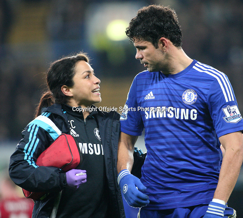 22 November 2014 - Barclays Premier League - Chelsea v West Bromwich Albion - Diego Costa of Chelsea talks to club physio Eva Caniero after being injured.<br /> <br /> <br /> Photo: Ryan Smyth/Offside