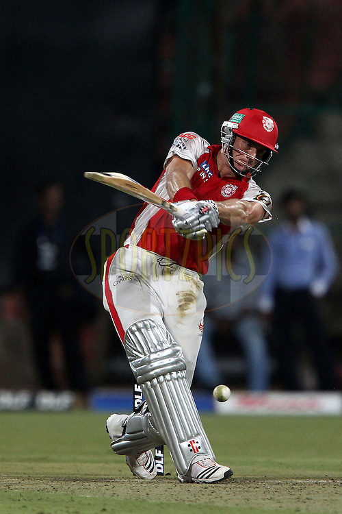 Ryan McLaren swings, misses and waits for the bails to fall during match 47 of the the Indian Premier League ( IPL ) Season 4 between the Royal Challengers Bangalore and the Kings XI Punjab held at the Chinnaswamy Stadium, Bangalore, Karnataka, India on the 6th May 2011..Photo by Ron Gaunt/BCCI/SPORTZPICS