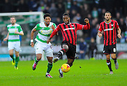 Yeovil Town's Sean Jeffers and Oxford Utd's Cheyenne Dunkley during the Sky Bet League 2 match between Yeovil Town and Oxford United at Huish Park, Yeovil, England on 28 December 2015. Photo by Graham Hunt.