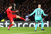 Chelsea goalkeeper Willy Caballero saves a shot from Bayern Munich forward Robert Lewandowski during the Champions League match between Chelsea and Bayern Munich at Stamford Bridge, London, England on 25 February 2020.