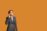 Happy mid adult woman talking on mobile phone