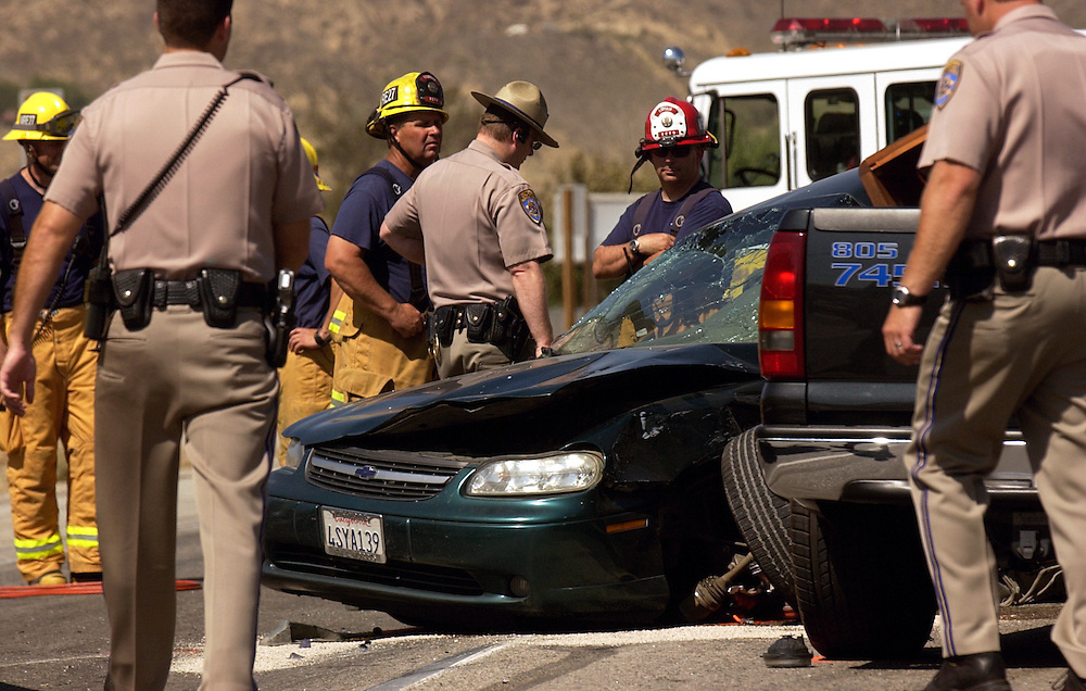 Jason Redmond / Star staff..Piru 6/28/06:  California Highway Patrol and Ventura County Firefighters investigate the scene of a fatal accident at the intersection on Main Street/Torrey Road and CA-126/Telegraph Road in Piru on Thursday afternoon. Herman Jimenez, driving a Chevy Malibu, was pronounced dead at the scene. A Ventura man driving a GMC pickup suffered minor injuries and left on his own to seek medical attention, according to CHP.