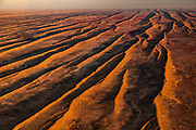 Simpson desert sand dunes run parallel with each other, aerial view, Northern Territory & Queensland, Central Australia