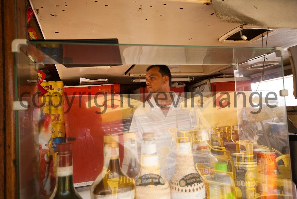 juice bar vendor takes an order on copacabana beach in rio de janeiro brazil.