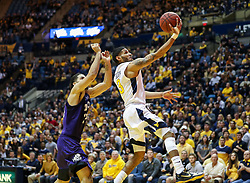 Feb 12, 2018; Morgantown, WV, USA; West Virginia Mountaineers guard James Bolden (3) shoots a layup during the second half against the TCU Horned Frogs at WVU Coliseum. Mandatory Credit: Ben Queen-USA TODAY Sports