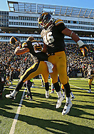 November 23 2013: Iowa Hawkeyes defensive back John Lowdermilk (37) and Iowa Hawkeyes tight end C.J. Fiedorowicz (86) celebrate after the end of the NCAA football game between the Michigan Wolverines and the Iowa Hawkeyes at Kinnick Stadium in Iowa City, Iowa on November 23, 2013. Iowa defeated Michigan 27-24. Iowa defeated Michigan 24-21.