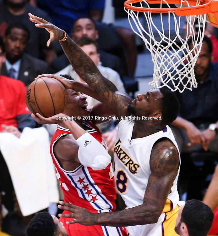 Philadelphia 76ers center Richaun Holmes (#22) gets fouled by Los Angeles Lakers center Tarik Black (#28) during an NBA basketball game Tuesday, March 12, 2017, in Los Angeles. <br /> (Photo by Ringo Chiu/PHOTOFORMULA.com)<br /> <br /> Usage Notes: This content is intended for editorial use only. For other uses, additional clearances may be required.