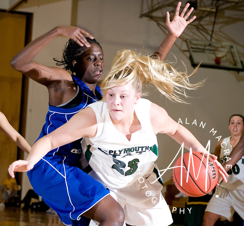 Plymouth State's Karly Gray is fouled by UMass Boston's Myrna Tangar during Saturday's match at Plymouth State.  (Alan MacRae/for the Citizen)