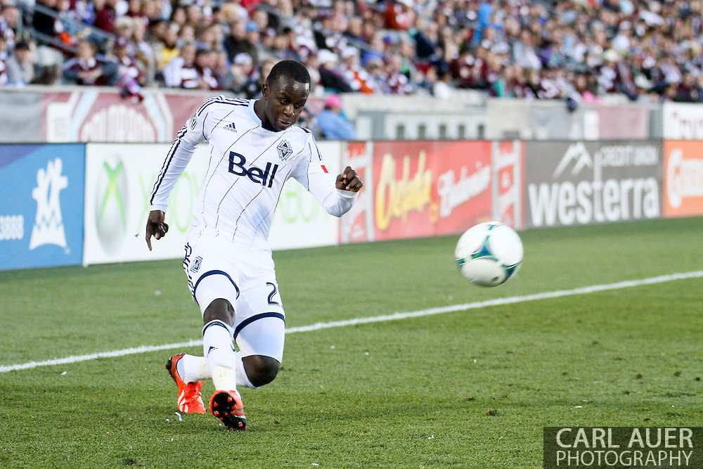 October 19th, 2013:  Vancouver Whitecaps FC forward/midfielder Kekuta Manneh (23) crosses a pass in the second half of the MLS Soccer Match between the Vancouver Whitecaps FC and the Colorado Rapids at Dick's Sporting Goods Park in Commerce City, Colorado