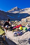 Climbers in camp at Dade Lake under Bear Creek Spire, John Muir Wilderness, Sierra Nevada Mountains, California