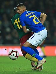 Cameroon's Jeando Fuchs and Brazil's Richarlison during the international friendly match at Stadium MK, Milton Keynes.