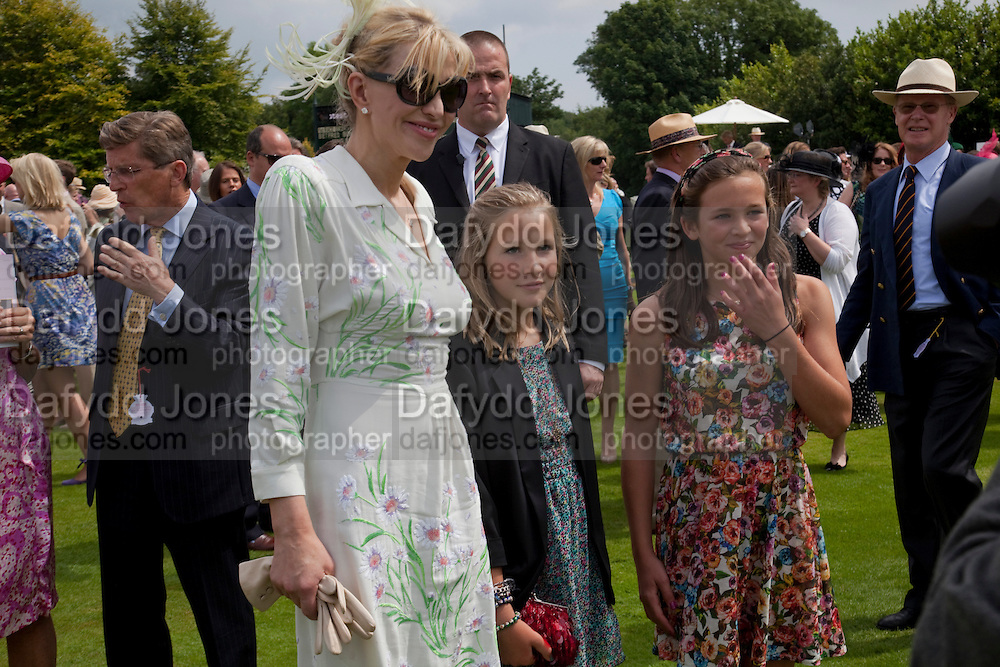 COURTNEY LOVE;LADY ELOISE GORDON-LENNOX;, MIA SELMAN;  IN THE PADDOCK, Glorious Goodwood. Ladies Day. 28 July 2011. <br /> <br />  , -DO NOT ARCHIVE-© Copyright Photograph by Dafydd Jones. 248 Clapham Rd. London SW9 0PZ. Tel 0207 820 0771. www.dafjones.com.