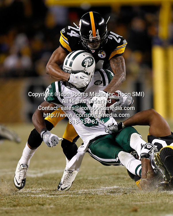 Pittsburgh Steelers cornerback Ike Taylor (24) takes down  New York Jets wide receiver Jerricho Cotchery (89) in the first half of the AFC Championship game at Heinz Field on January 23, 2011 in Pittsburgh, PA..