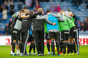 The Legia Warsaw team form a huddle during the warm up before the Europa League Play Off leg 2 of 2 match between Rangers FC and Legia Warsaw at Ibrox Stadium, Glasgow, Scotland on 29 August 2019.